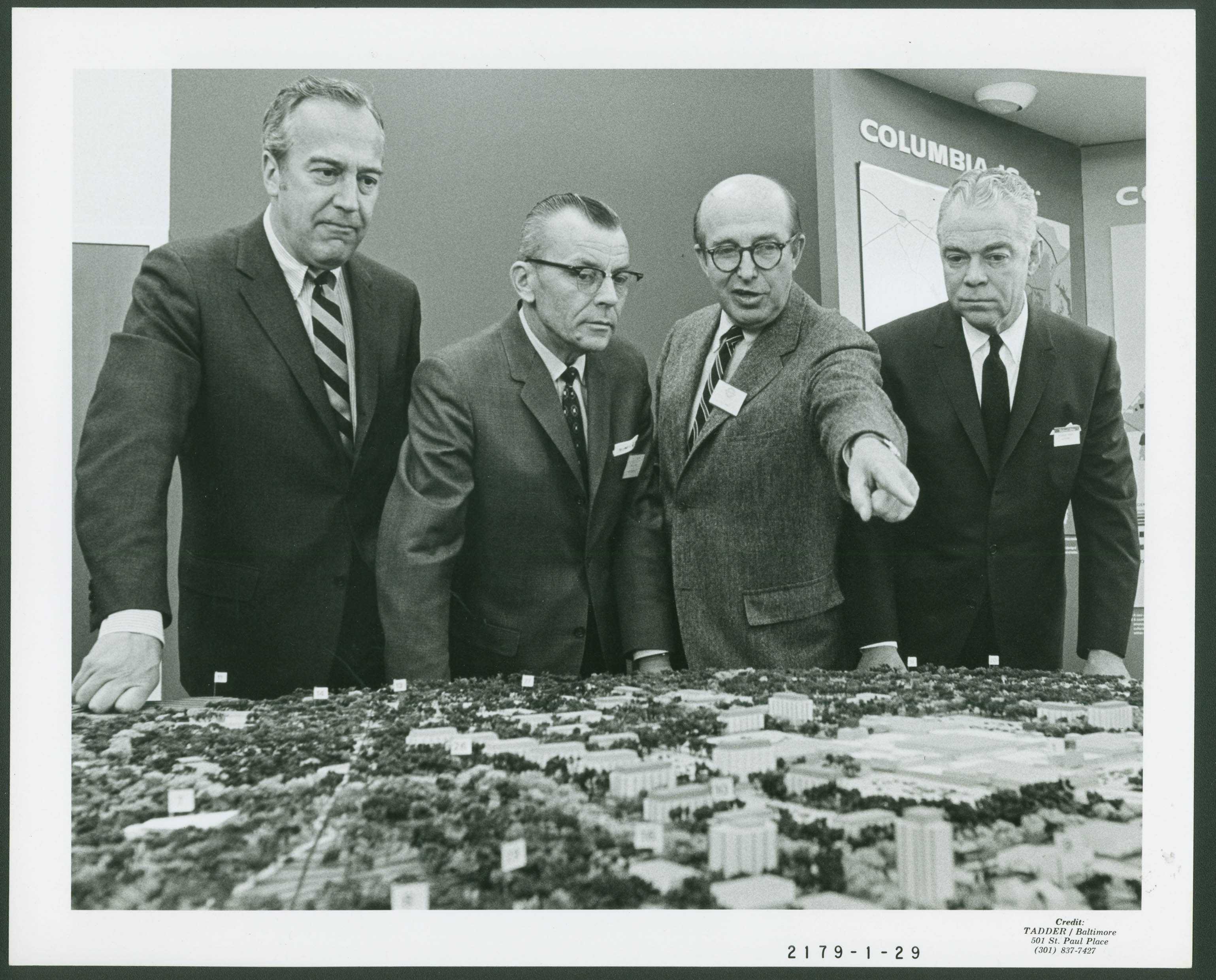Jim Rouse and model of Columbia. Photo courtesy of the Columbia Archive.