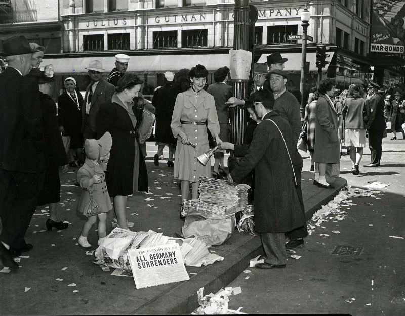 """""""All Germany Surrenders"""" reported on VE Day, 1945. Photo by A. Aubrey Bodine for The Sun."""