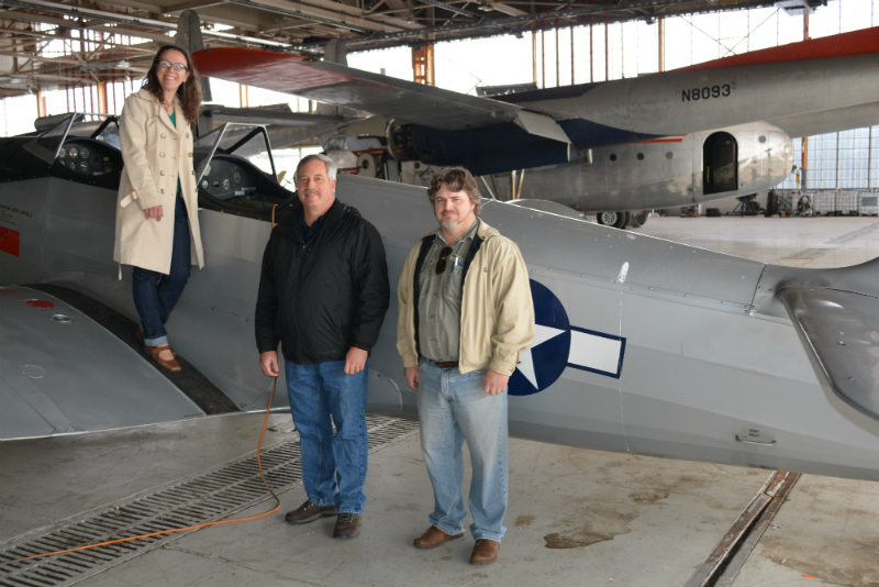Members of Preservation Maryland, and others, pose with an airplane at Hagerstown Aviation Museum