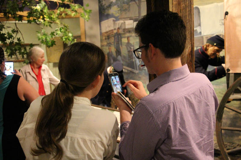 Katherine Boyle (left) and Ben Israel come up with a hashtag while exploring the Civil War Medicine Museum.