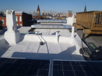 Solar panels on a historic flat roof. Photo by Maryland Historical Trust.