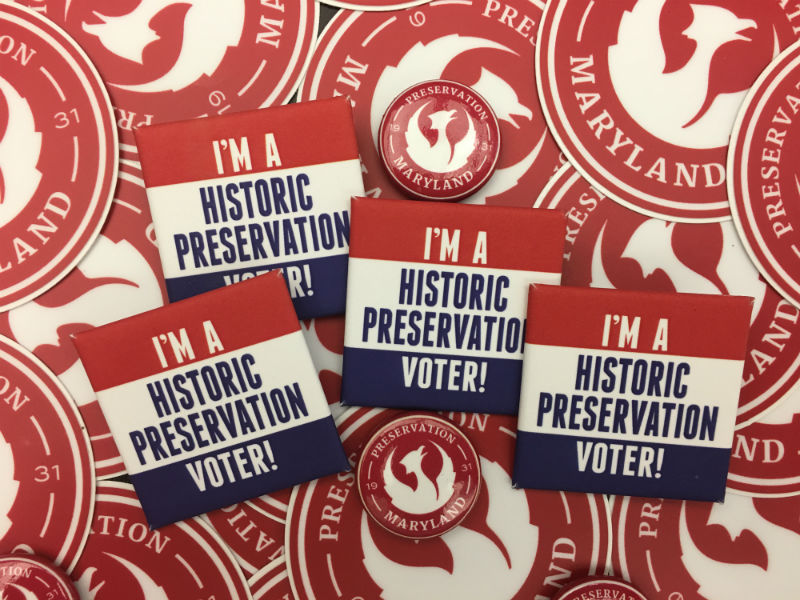"""Image of Pins reading """"I'm a historic preservation voter!"""""""