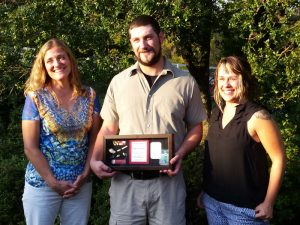 Matt Nickelson receives award with Stephanie Sperling and Mandi Melton.