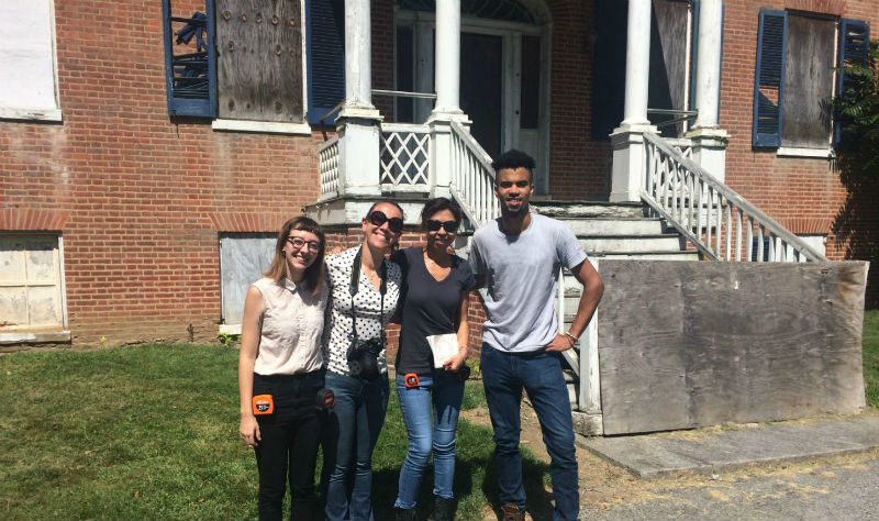 Michelle with architect My Ly (center) documenting Holly Hall, 2016