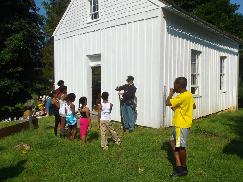 Image of Tolson's Chapel, which now stands as a restored African-American school house