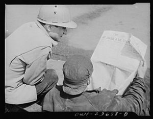 Workers at the Bethlehem-Fairfield shipyards reading The Sun, 1943. Photo from the Library of Congress.