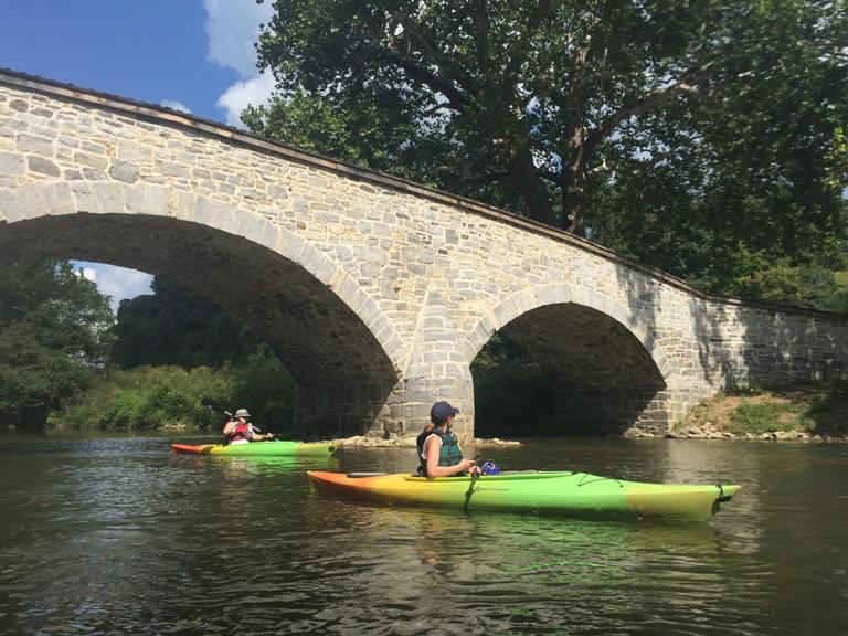Kayaks pass under the ca. 1836 Burnside's Bridge.