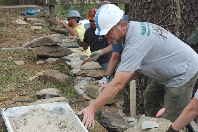 Trained masons restacking the historic stonewalls at Shafer Farm, 2017.