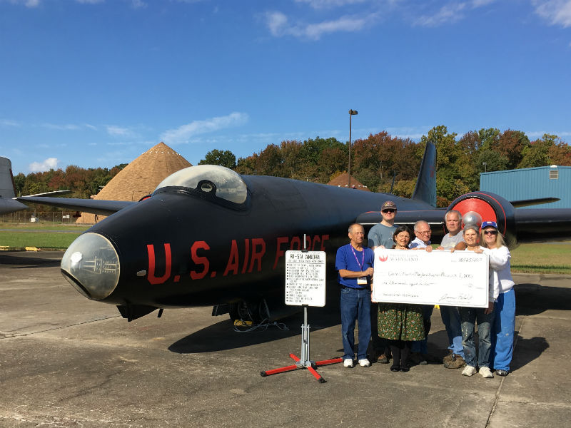Grant check presentation at the airfield, 2017.