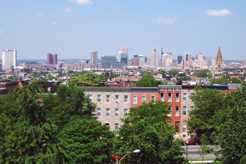 The City of Baltimore skyline above historic rowhomes.