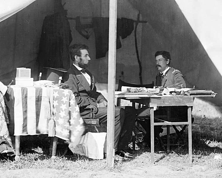 President Lincoln and Gen. McClellan meet in the general's tent outside of Sharpsburg, Maryland. Library of Congress.