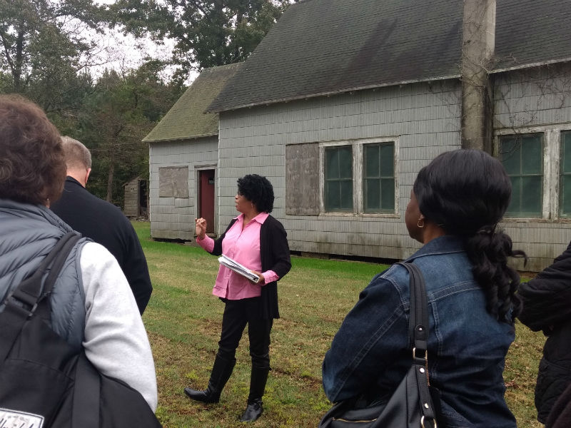 Renna M. giving a tour at Malone's Church, 2018.