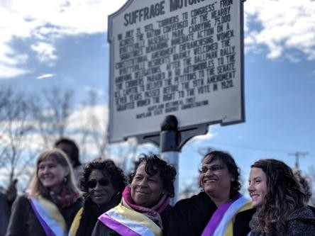 Kacy Rohn, right, at Suffrage Motorcade historic sign, 2018.