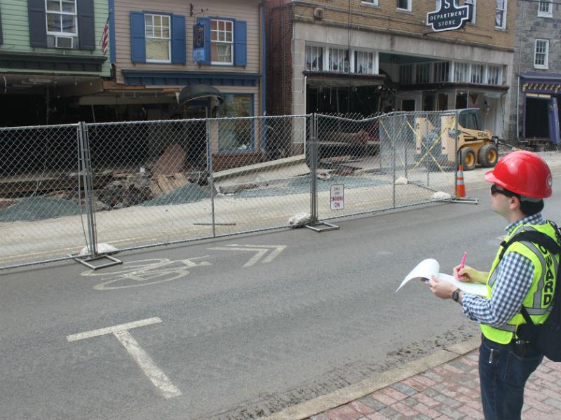 Nicholas Redding surveying Ellicott City flood damage, 2016.