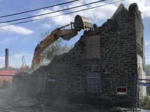 Demolition of one of the Woodberry stone houses, 2019. Photo by Fred Scharmen.