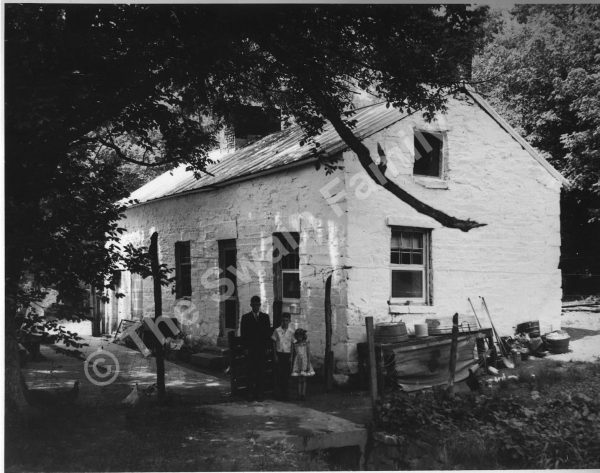 Robert, Frederick, and Barbara Swain at the lockhouse, ca. 1945. Photo from The Swain Family.