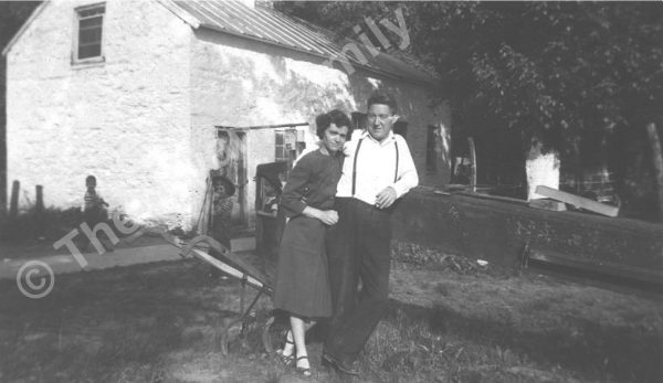 Virginia and Robert Swain, with hand plow and family in background. Photo from The Swain Family.