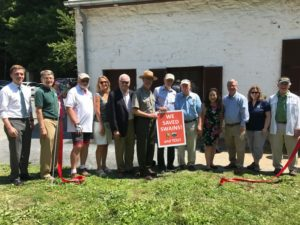 Dignitaries pose after cutting the ribbon marking Swains Lockhouse on the C&O Canal open, 2019.