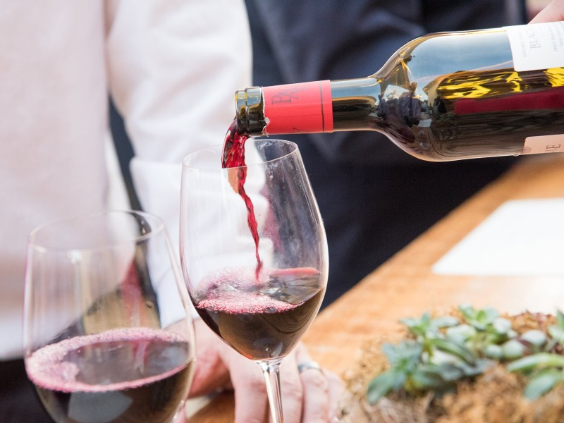 Red Wine Being Poured into Wine Glass from Black Ankle Vineyards