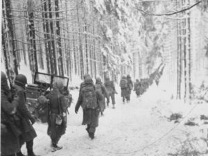 American Soldiers on a snowy road during the Battle of the Bulge, 1944.