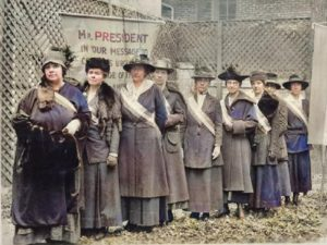 Digitally colorized image of suffragists. Original image from the Library of Congress.