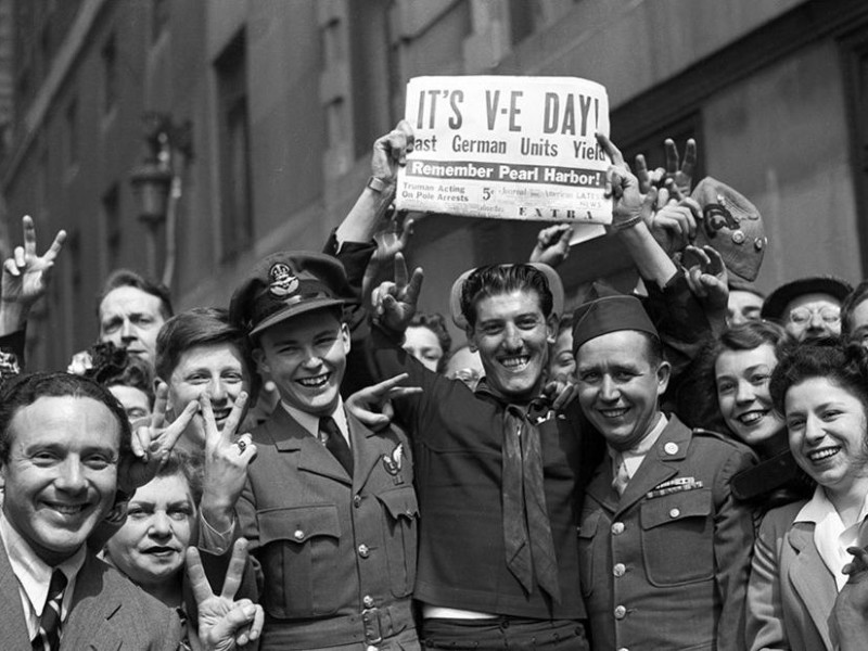 VE-Day celebrations on the streets of London, 1945. Image from Getty Images via BBC.