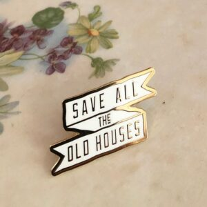 "Image of enamel pin reading ""Save all the Old Houses"""