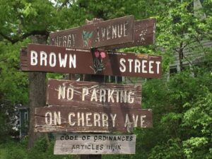 Restored sign among deteriorated signs in Washington Grove, MD, 2019.