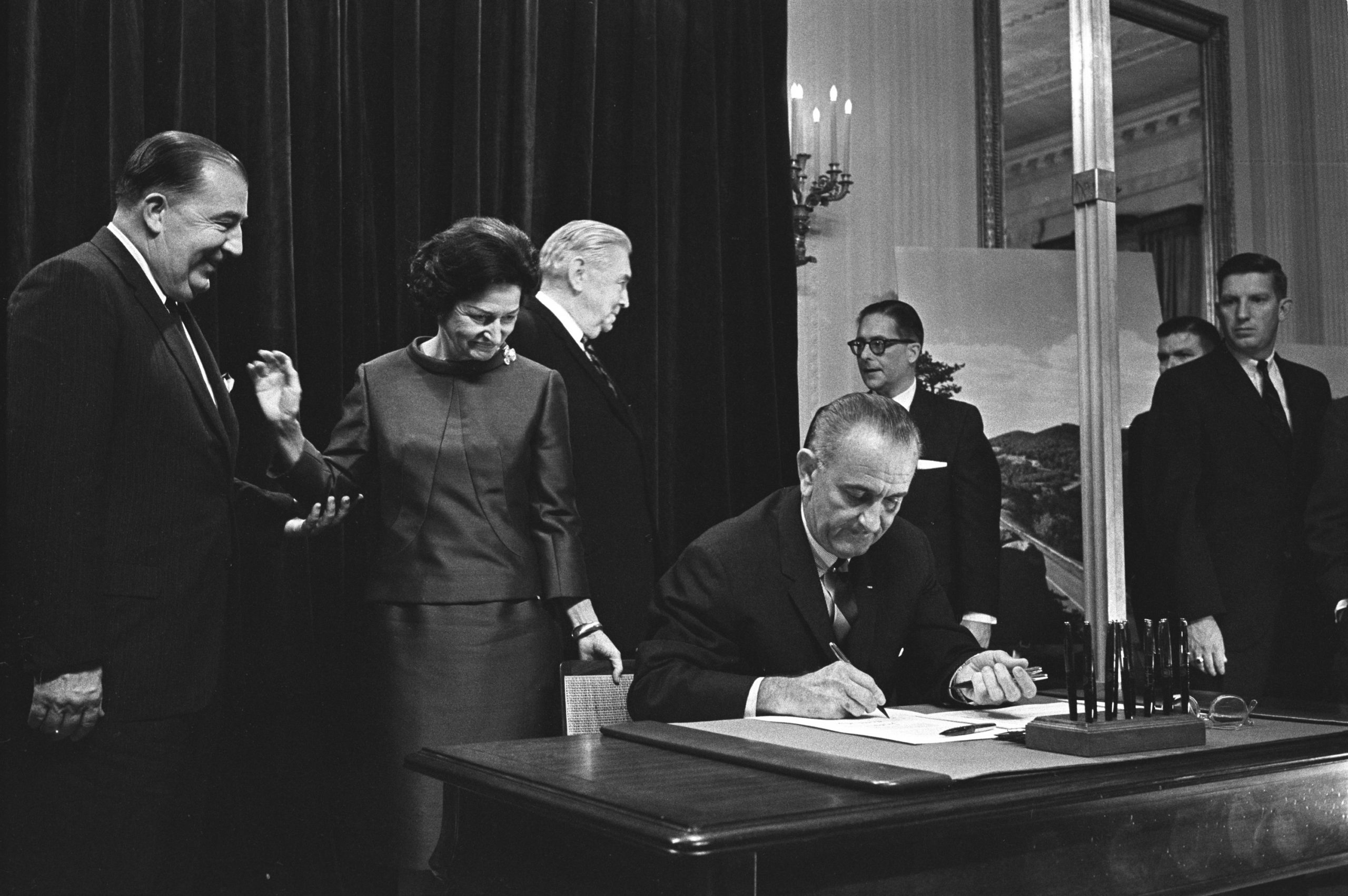 The National Historic Preservation Act of 1966 was signed into law under President Lyndon B. Johnson. Pictured above, just one year prior, President Johnson signed the Highway Beautification Act of 1965.