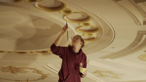 A National Park Service employee skilled in the traditional trades works to restore the ceiling in historic Ford's Theatre