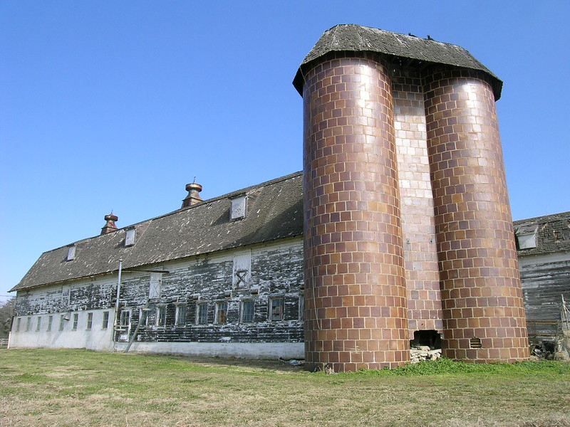 The dairy barn at Mulberry Hill Farm. The silos are covered in tile. The main house was restored and moved at some point to Easton.