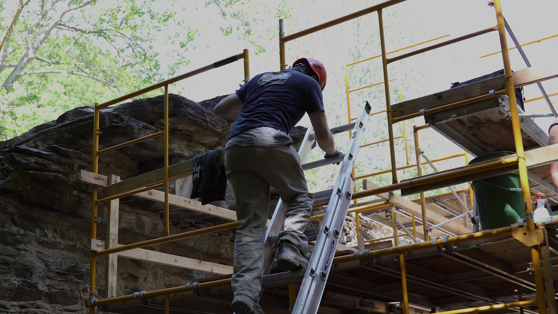 An NPS employee skilled in the traditional trades works at the Pulp Mill Ruins in Harpers Ferry, WV